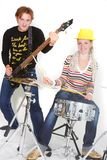 Man and woman playing guitar and drums Stock Photos