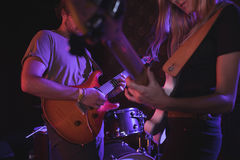 Man and woman playing guitars in nightclub Royalty Free Stock Images