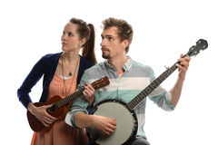 Man and Woman Playing Instruments Stock Images