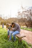 Man and woman playing with little girl sitting on Royalty Free Stock Photos
