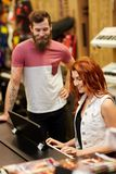 Man and woman playing piano at music store Royalty Free Stock Image