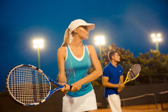 Man and woman playing tennis Royalty Free Stock Photography