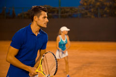 Man and woman playing in tennis Royalty Free Stock Image