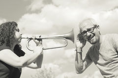 Man and woman playing trumpet Royalty Free Stock Photos