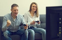 Man and woman playing video game stock photo