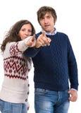 Man and woman pointing at camera Royalty Free Stock Photos
