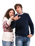 Man and woman pointing at camera Stock Images