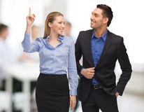 Man and woman pointing finger Stock Images