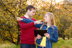 man and woman pointing in opposite directions Royalty Free Stock Image