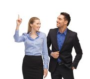 Man and woman pointing their fingers Stock Image