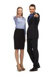 Man and woman pointing their fingers Stock Photography