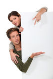 Man and woman pointing Stock Images