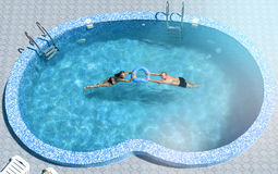 Man and woman in the pool Stock Image