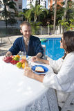 Man and Woman Beside a Pool - Vertical Royalty Free Stock Photo