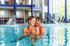 Man and woman in pool of wellness thermal spa Royalty Free Stock Images