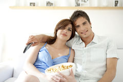 Man and Woman With Popcorn Smiling Royalty Free Stock Photography