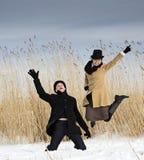 Man and woman posing near lake beach Stock Photography