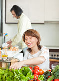 A man and a woman with a positive vegetables in the kitchen Stock Photography