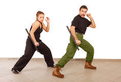 Man and woman practce with truncheon Royalty Free Stock Image