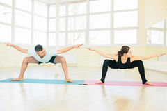 Man and woman, practice exercises Stock Photos