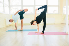 Man and woman, practice exercises in a training hall Stock Photo