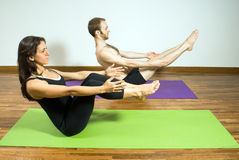 Man and Woman Practice Yoga - Horizontal Stock Photo