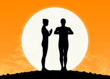 Man and woman practicing yoga at sunrise Royalty Free Stock Photo