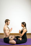 Man and Woman Practicing Yoga - Vertical Stock Photography
