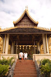 Man and woman praying at a temple. Man and woman praying at Pha That Luang (Great Sacred Stupa) in Vientiane in Laos Royalty Free Stock Photo