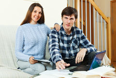 Man and woman prepare for examinations. Man and women prepare for examinations at home stock photo