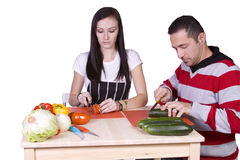 Man and Woman Preparing Food Stock Images