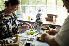 Man and woman preparing a meal. Man and women preparing a meal Stock Photography