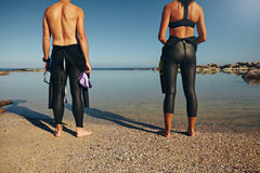 Man and woman preparing for triathlon Stock Photography