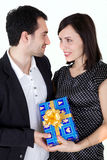 Man and woman with present. Isolated on white Royalty Free Stock Photography