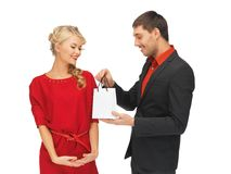 Man and woman with present Stock Images