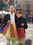 Man and woman with purchases at street Stock Image