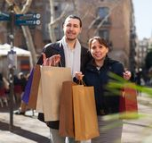 Man and woman with purchases Royalty Free Stock Photo