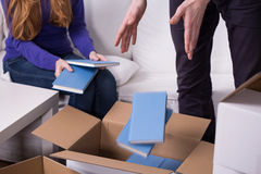 Man and woman putting things Stock Photography