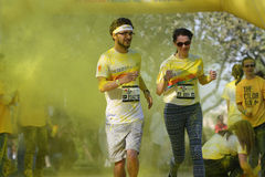 Man and woman racing at Color Run Bucharest Stock Photography