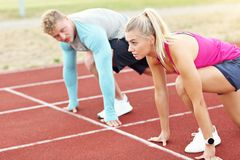 Man and woman racing on outdoor track Stock Photography
