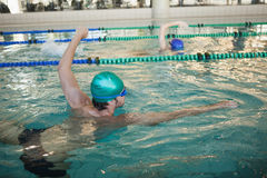Man and woman racing in the swimming pool Stock Images