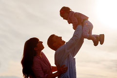 Man and woman raise the child in arms. Man and women raise the child in arms Stock Image