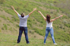 Man and Woman Raising Hands Royalty Free Stock Image