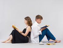 Man and woman reading books together Stock Photo