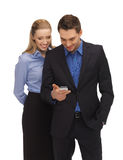 Man and woman reading sms Stock Image