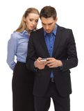 Man and woman reading sms Royalty Free Stock Images