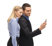Man and woman reading sms Stock Photography