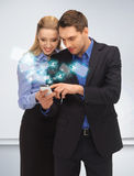 Man and woman reading sms Stock Photo