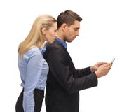 Man and woman reading sms Royalty Free Stock Photography