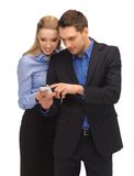 Man and woman reading sms Royalty Free Stock Image